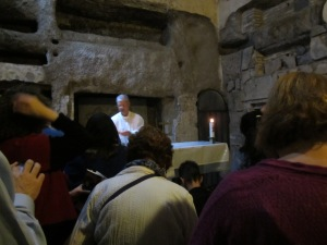 Father preparing for mass in Catacombs of San Callisto